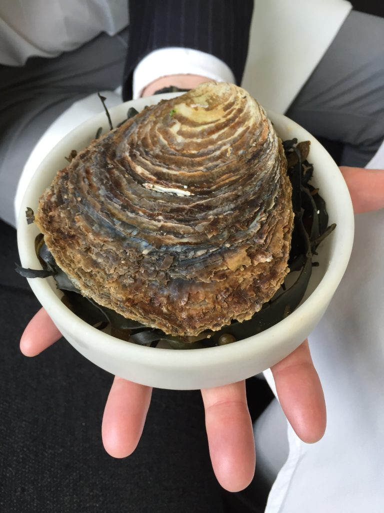 Hand-size oyster at Geranium- Copenhagen, Denmark