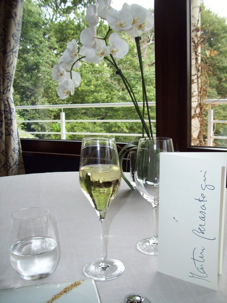 Champagne and menu on dining table at Martin Berasategui in Spain