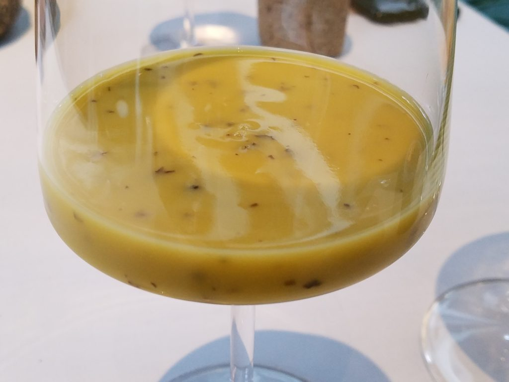 Juice pairing of avocado, passionfruit and yuyu at Central in Lima, Peru