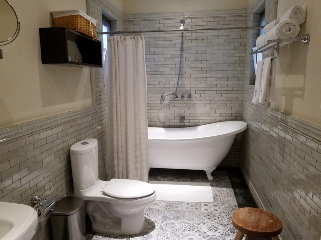 Hotel Bathroom with full tub at La Santisma Trinidad Winery, Mexico