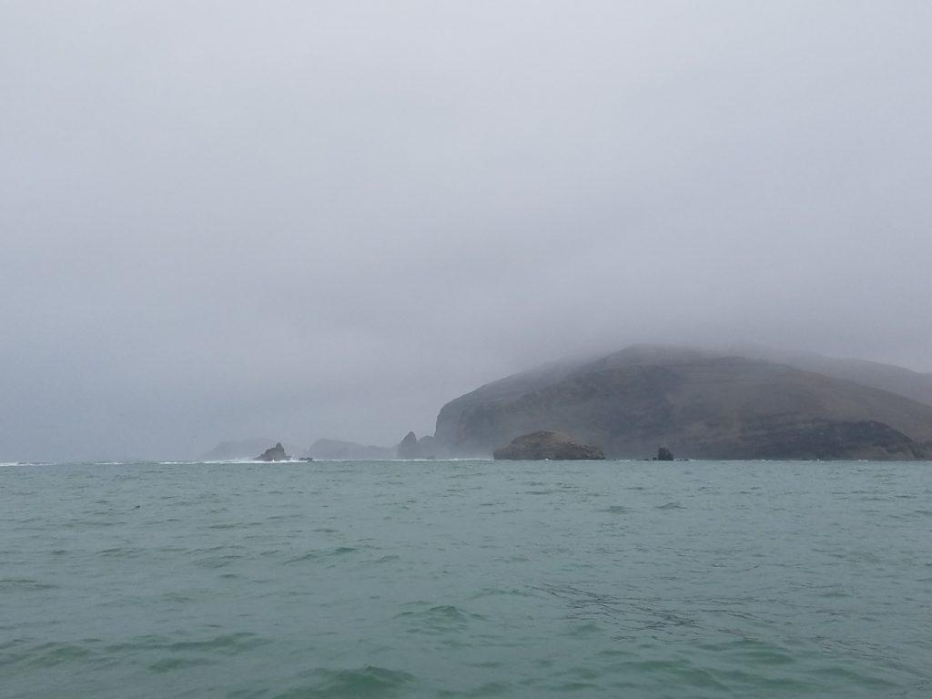 Foggy day heading out to Palomino Island, Peru