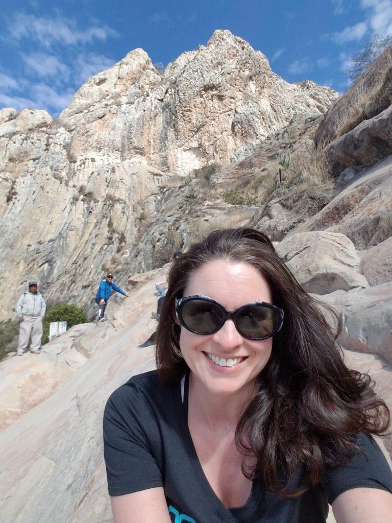 Tiffany hiking on Peña de Bernal.