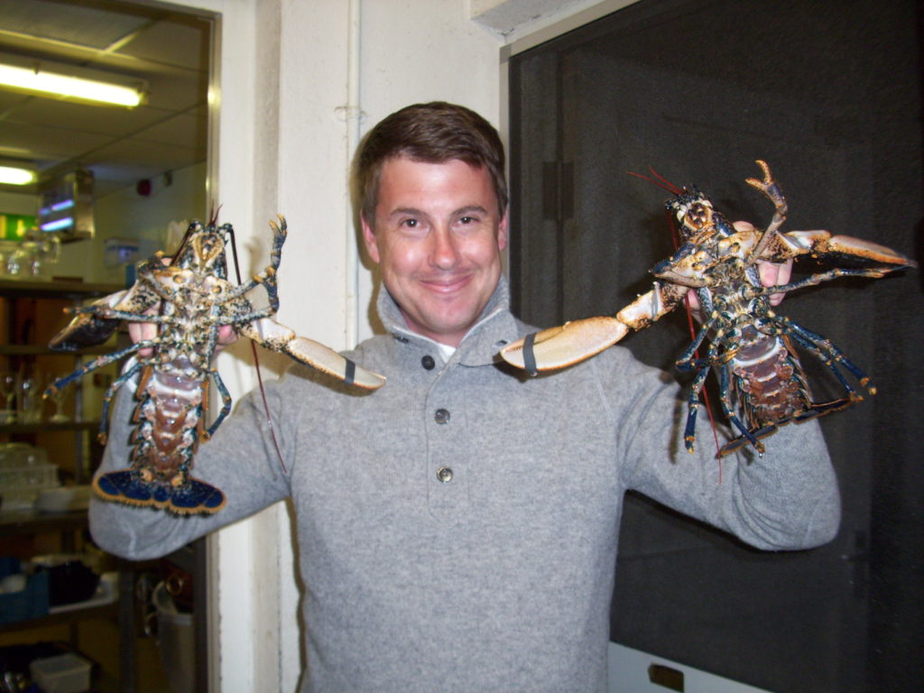 Tom holding our lobster dinners up at King Sitric, Howth, Ireland
