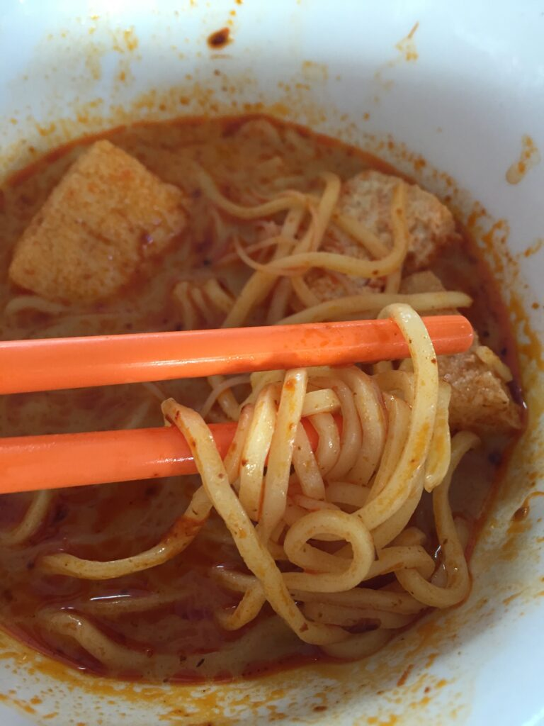 Singapore Laksa, a spicy, rice noodle soup with coconut milk, chicken and shrimp