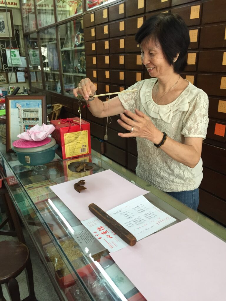 Chinese medicine woman in Penang