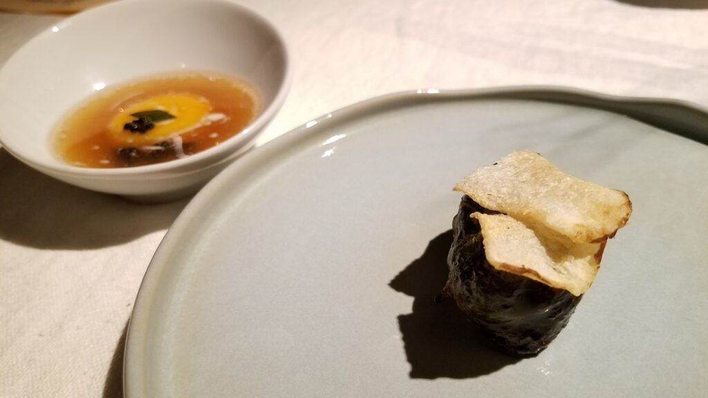 Dreznica lamb and lobster roll, lamb soup, yolk stuffed with anchovies. Hisa Franko