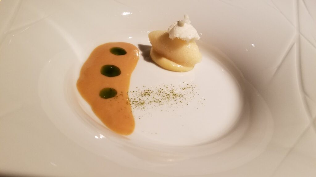 Apple croissant with goat's milk, rose hip stuffing, baked apple ice cream and beeswax. Hisa Franko